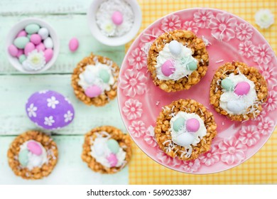 Easter nest cookie cake dessert with candy eggs and whipped cream