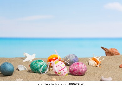 Easter on beach background. Eggs on the sandy by the ocean. Vacation and travel, spring concept