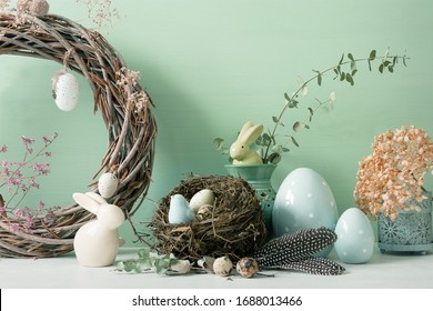 Easter ornaments in light and pastel colors with clear light, with eggs and rabbits, ornaments for the home, interior, bird nest with eggs inside
