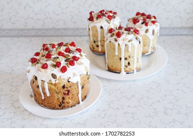 Easter orthodox sweet bread, kulich with berries and pumpkin seeds. Christian holidays concept with copy space.