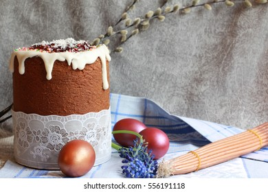 Easter orthodox sweet chocolate bread topped with white icing and colorful eggs, 33 Holy wax candles from Jerusalem on the linen napkin. Easter holidays background with copy space