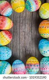 Easter painted eggs on a wooden background