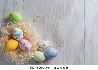 Easter painted eggs on wooden rustic table, holiday background for your decoration