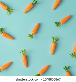 Easter pattern made with carrots on bright blue background. Creative minimal holiday concept.Flat lay.