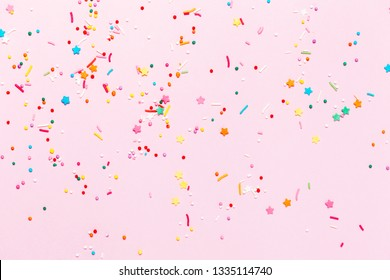 Easter Pink confetti and stars and sparkles on pink background. Top view, flat lay. Copyspace for text. Bright and festive holiday background.