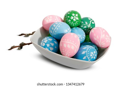 Easter plate with Easter eggs and willow catkins isolated on a white background