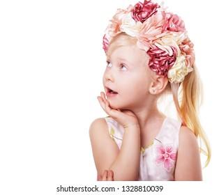 easter portrait of little blond girl wearing pink flower wreath or crown