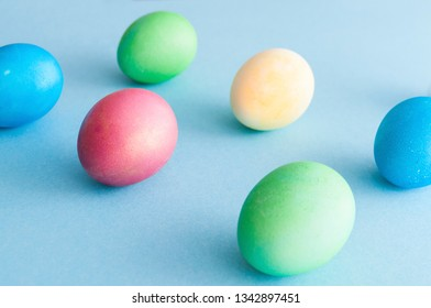Easter poster with colorful eggs on light blue background