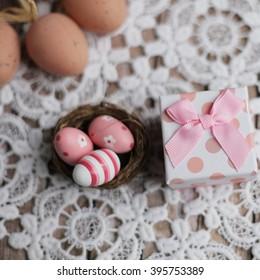 Easter present. Easter chalkboard. Easter eggs. easter nest. Easter nest on the lace. easter lace.