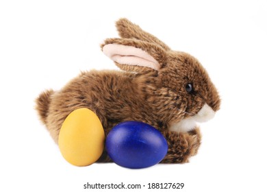 Easter rabbit and colorful eggs. Isolated on a white background.