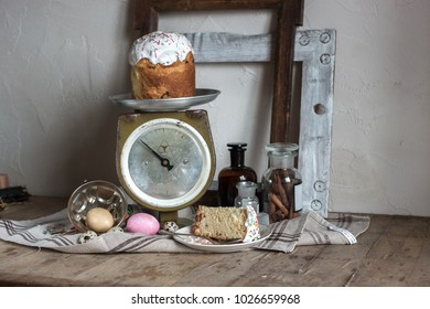Easter rustic country still life of scale, old wood frames, painting and quail eggs, glass bottle with cinnamon sticks, feud cloth and bast on the wooden table. Shabby chic still life composition.