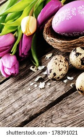 Easter setting in purple tone with decorative and quail eggs