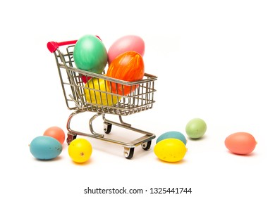 Easter shopping. Handmade colored eggs in cart. Business and selling in spring
