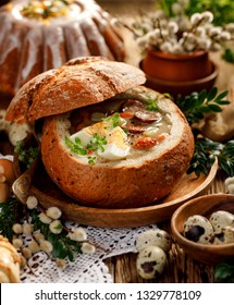 Easter soup, The sour soup (Żurek) made of rye flour with smoked sausage and eggs served in bread bowl. Traditional polish sour rye soup, popular Easter dish