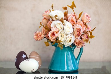 Easter and spring background with Easter eggs, vase and flowers in pastel colors