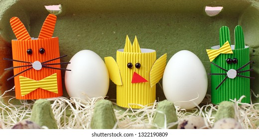 Easter spring decorative composition with homemade easter paper craft funny rabbit, chickens and quail eggs .Holiday celebration decorations.