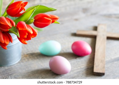 Easter spring red tulips and cross on abstract wooden background