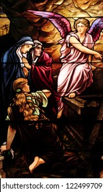 Easter stained glass window depicting Mary Magdalen and women at the empty tomb of Jesus on day of Resurrection