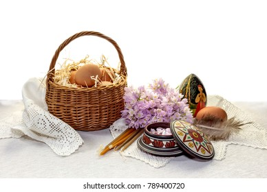 Easter still life. Church candles, frankincense and eggs in a nest close-up on a table.