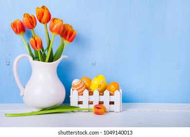 Easter still life with Easter eggs and tulips. Easter eggs in a white box.  Easter greeting card.