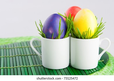 Easter still-life. Colored eggs on a green mat.