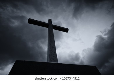 Easter Sunday Concept: Silhouette the cross over blurred cloudy background