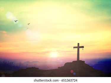 Easter Sunday concept: Silhouette the cross on mountain sunset background