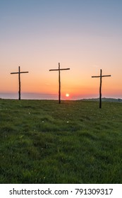Easter sunrise on downland hills, crosses , replica crucifix to celebration christian festival.