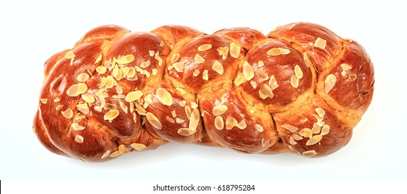 Easter sweet bread, greek tsoureki, challah isolated on white background - top view