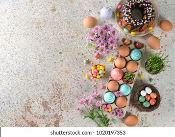Easter sweets and decorations on a brown background