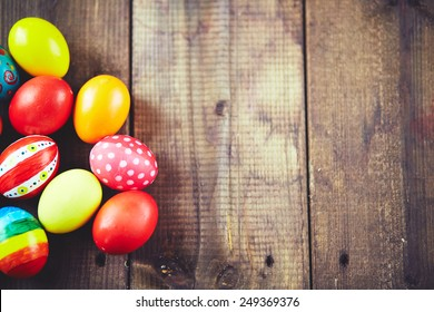 Easter symbols on wooden background