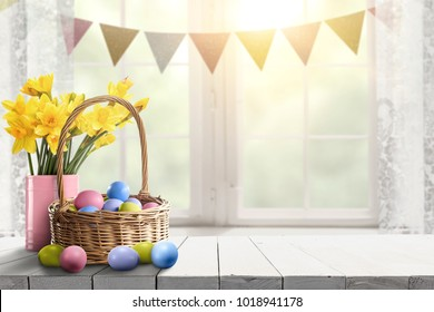 Easter table background of free space for your product. Blurred window background. Eggs and flowers decoration.
