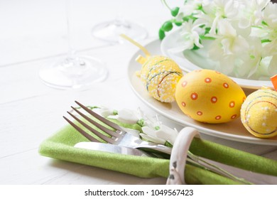 Easter table set in yellow green colors