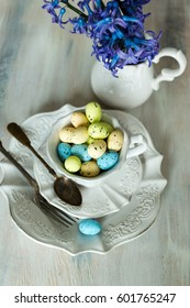 Easter table setting with  colorful eggs with Blue hyacinths