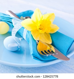 easter table setting with daffodil and cutlery