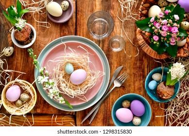 Easter table setting, holiday table home decor idea, flat lay composition with cutlery, Easter eggs and fresh flowers