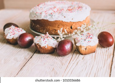 Easter table with traditional Easter cakes and Easter eggs with blossoming tree branch, religion