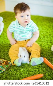 Easter theme with small boy with  with the carrot and the rabbit