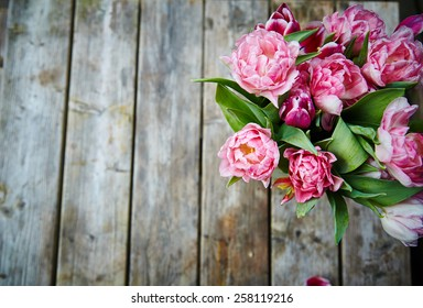 Easter time. Spring. Pink tulips on wooden background.