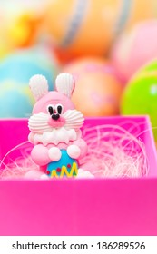Easter toy bunny with colored eggs