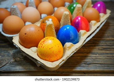 Easter tradition - Easter colorful  chicken eggs  on a gray background - Easter composition. - Selective focus