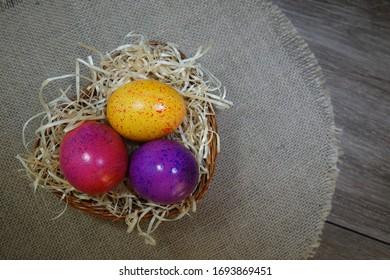 Easter tradition - Easter colorful eggs and quail eggs   on a gray background - Easter composition. - Selective focus
