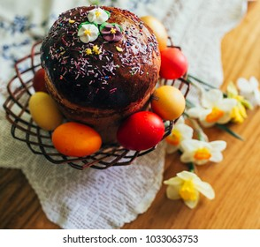 Easter traditional bread (also known as Kulich or Paskha) and colorful eggs on a table