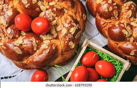 Easter traditional bread and red eggs on a table -  top view