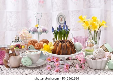 easter traditional marble ring cake and cupcakes with beautiful decorations  on festive table