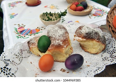 Easter traditions - colorful eggs placed in a traditional sweet bread.
