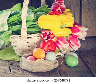 Easter tulip flowers in wooden background