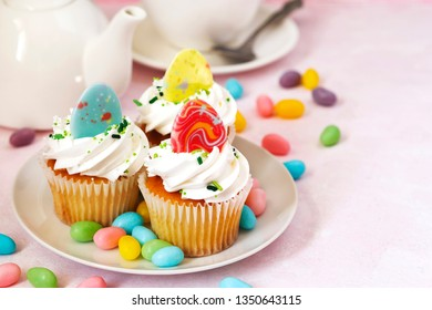Easter vanilla cupcakes on pink background, copy space
