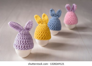 Easter white eggs in the form of decorative bunnies.
