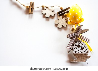 Easter wooden bunny with yellow polka dots eggs. Easter mood.